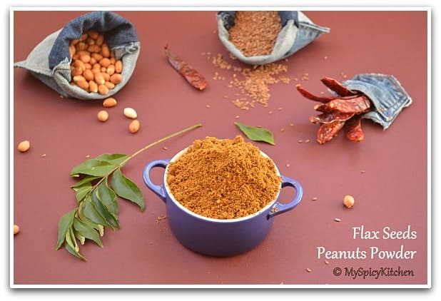Bowl of Flax Seeds Groundnut Powder along with some of the ingredients used to prepare the spice powder; a bag of peanuts flax seeds and some red chilies