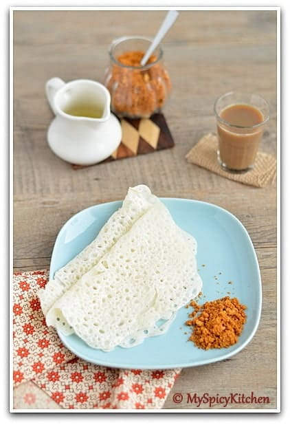 Chila, also know as biyyam attu or rice dosa in a plate served with peanut powder.