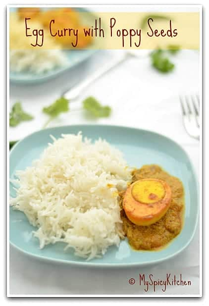 Dim Posto - Bengali Egg Curry and rice in a blue plate.