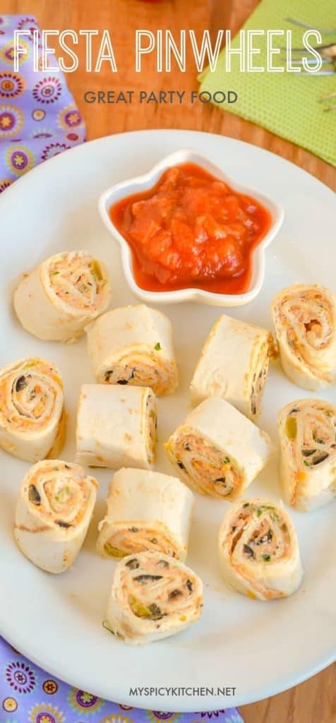 A Pinterest pin of fiesta pinwheels in a platter along with a bowl of salsa, and some napkins & forks on the side