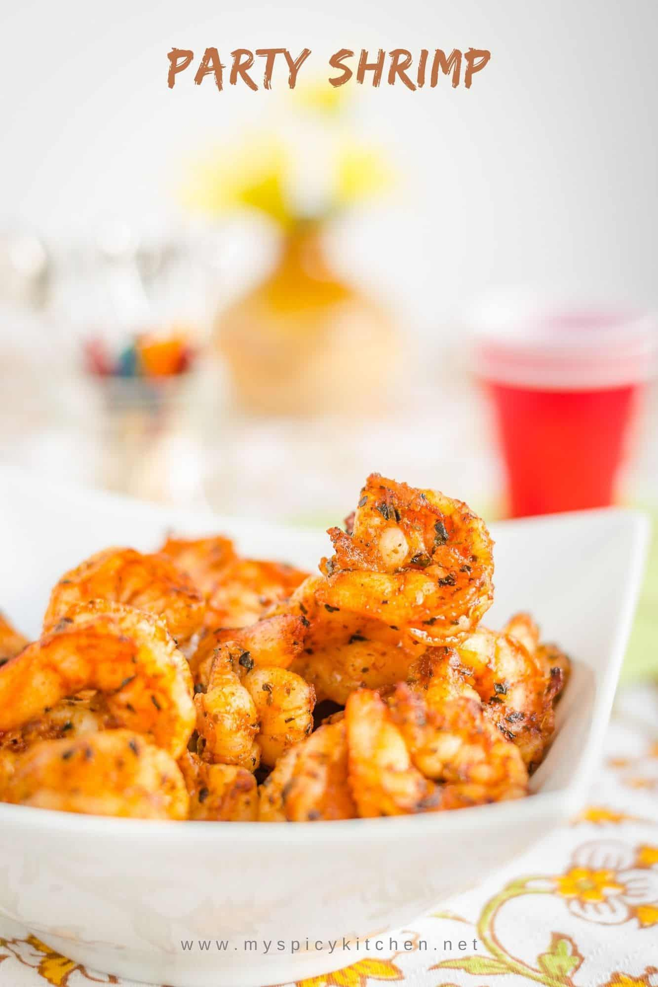 A bowl of party shrimp, marinated in Italian seasoning and broiled