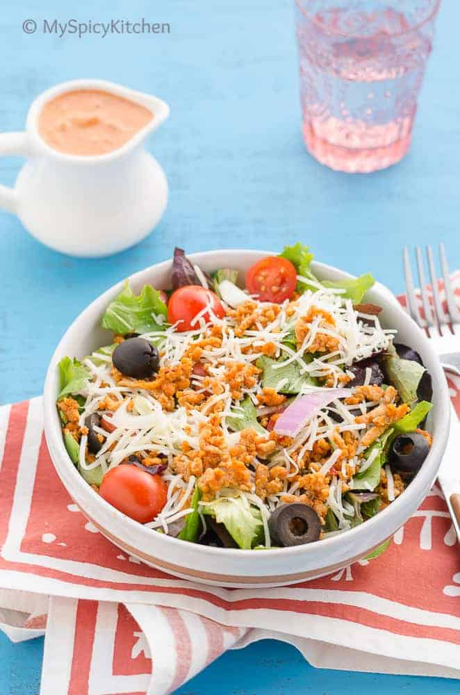 Ground chicken taco salad is an easy weeknight salad and a great for potlucks.