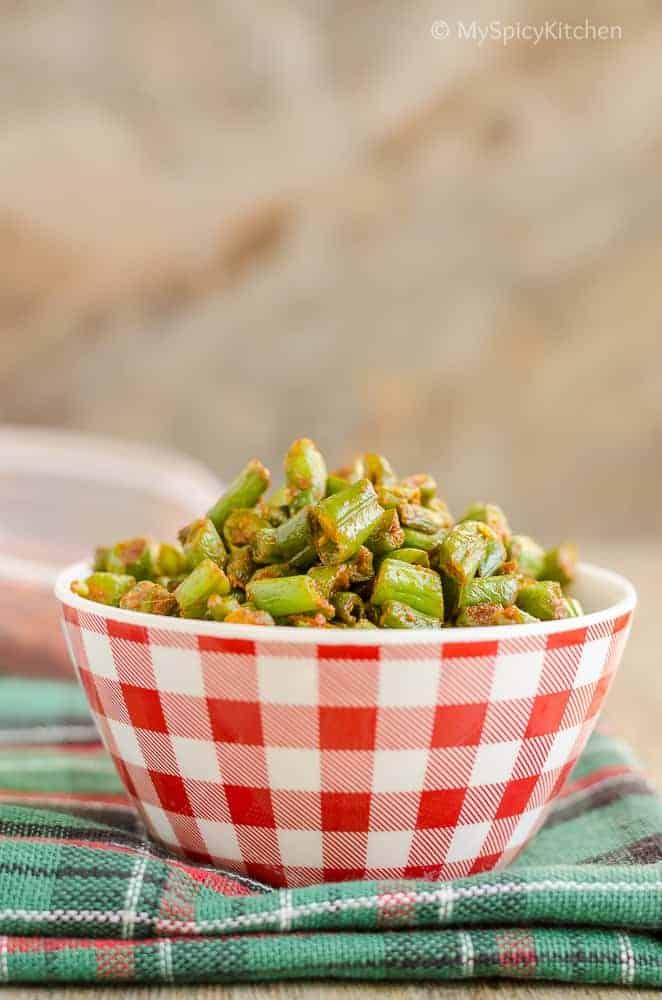 bowl of green  beans sauteed with Kolhapuri