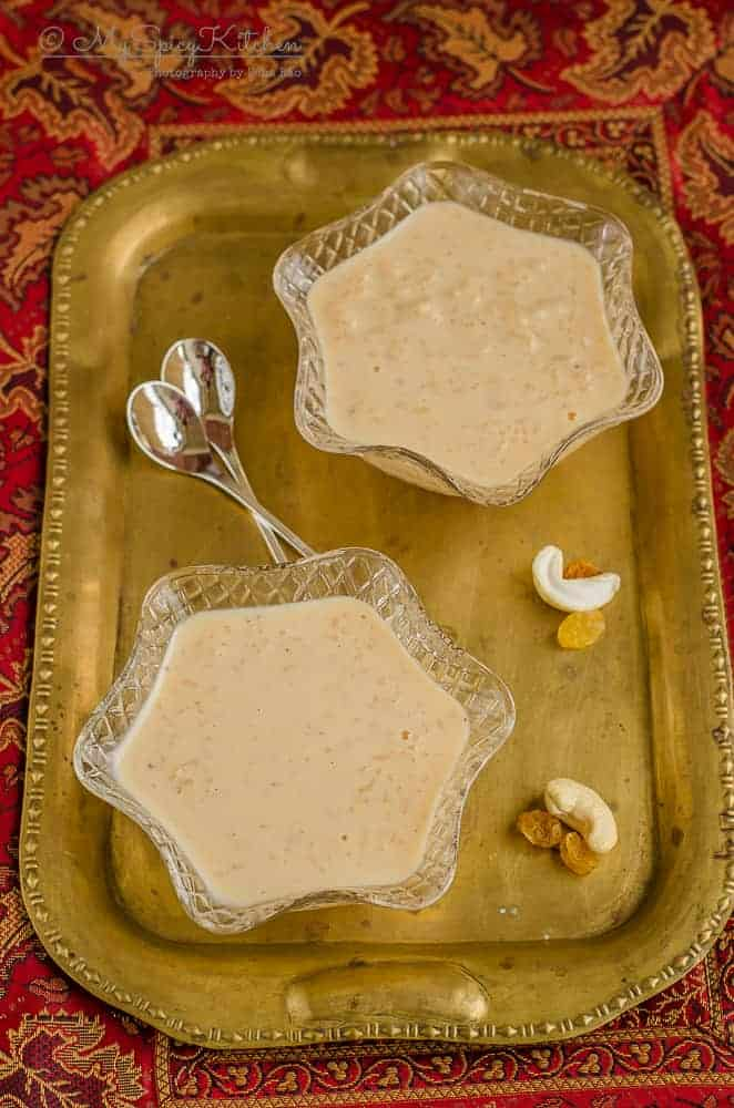 2 bowls of caramel rice pudding in a brass tray