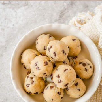 Bowl of edible chocolate chip cookie dough balls that are gluten free and make a great snack.