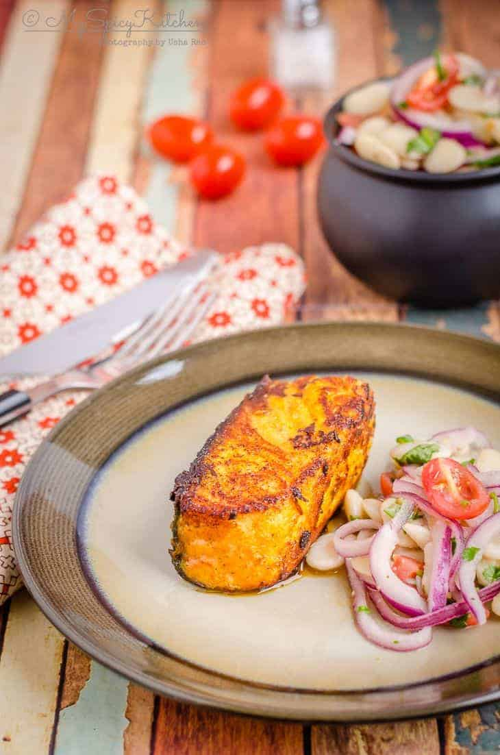 A plate of pan seared tandoori salmon with some lima beans salad. It is a healthy, quick and easy recipe