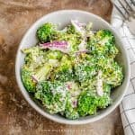 A bowl of roast broccoli salad with hemp seeds tossed in mayo sour cream dressing