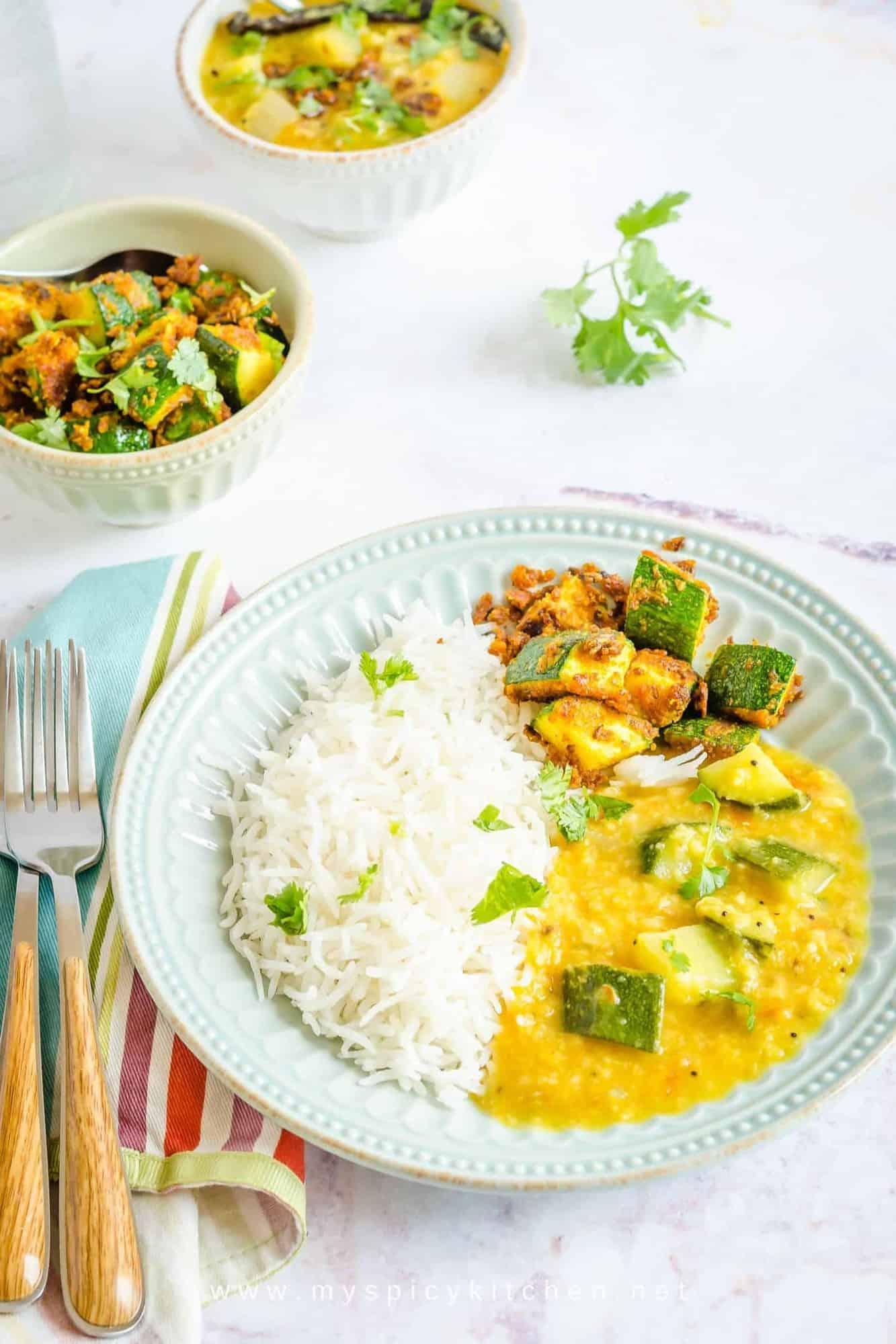 Plate of rice, zucchini dal and zucchini stir fry
