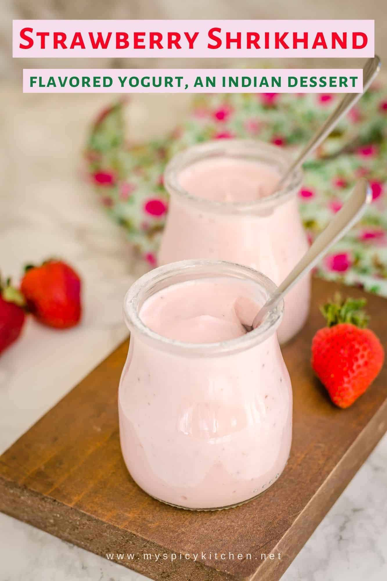 Jars of strawberry shrikhand on a wooden board
