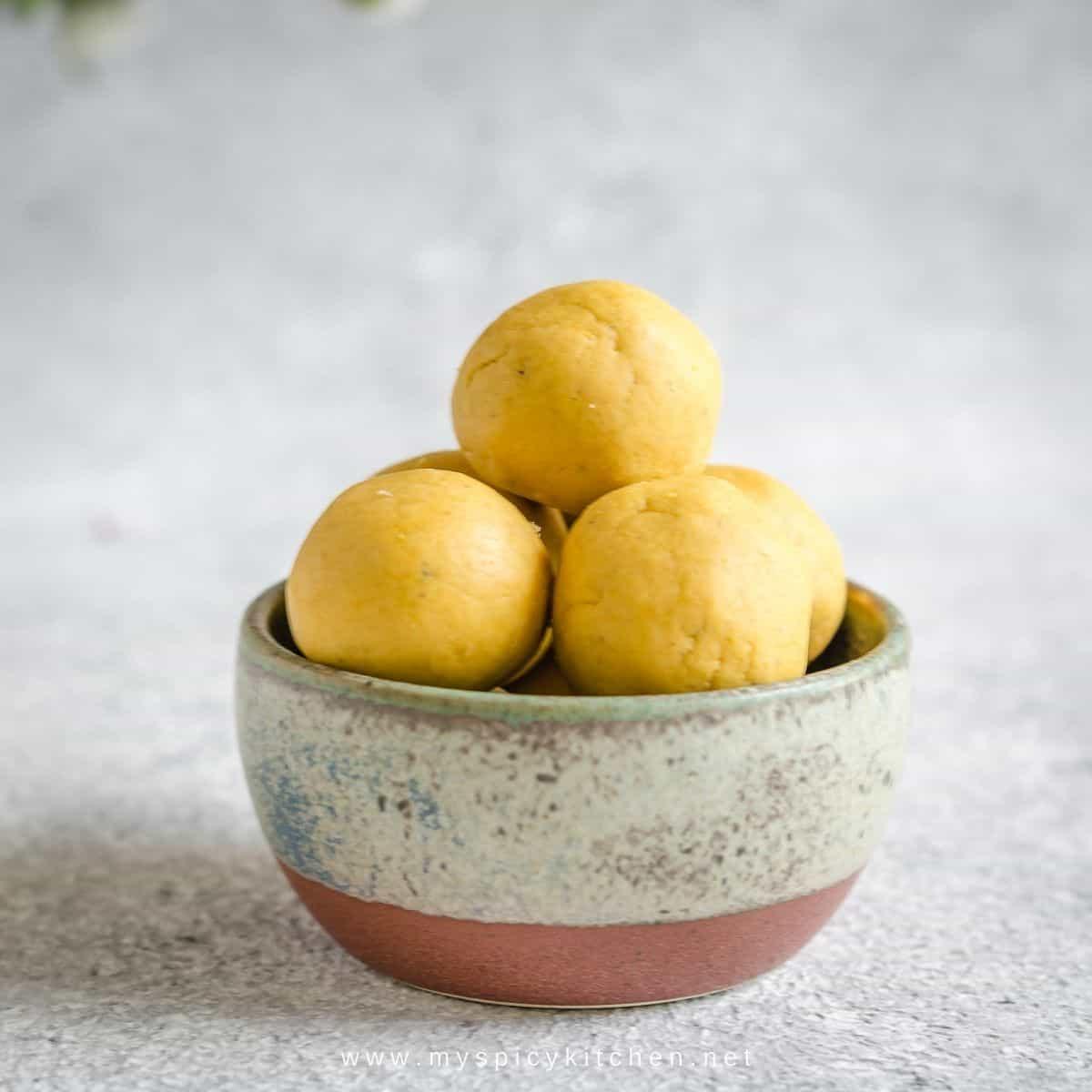 A bowl of senaga pappu laddulu.