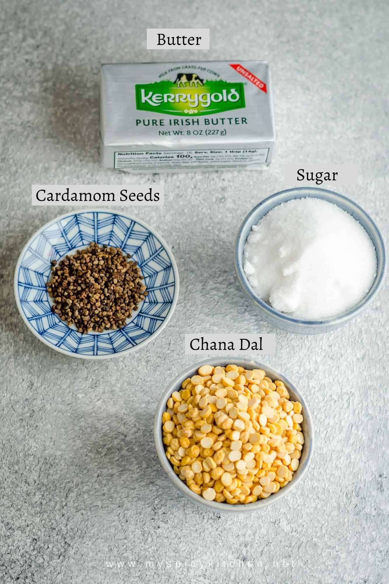 Ingredients for chana dal ladoo - chana dal sugar cardamom seeds and butter for ghee.