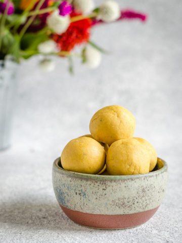 Bowl of chana dal laddu.