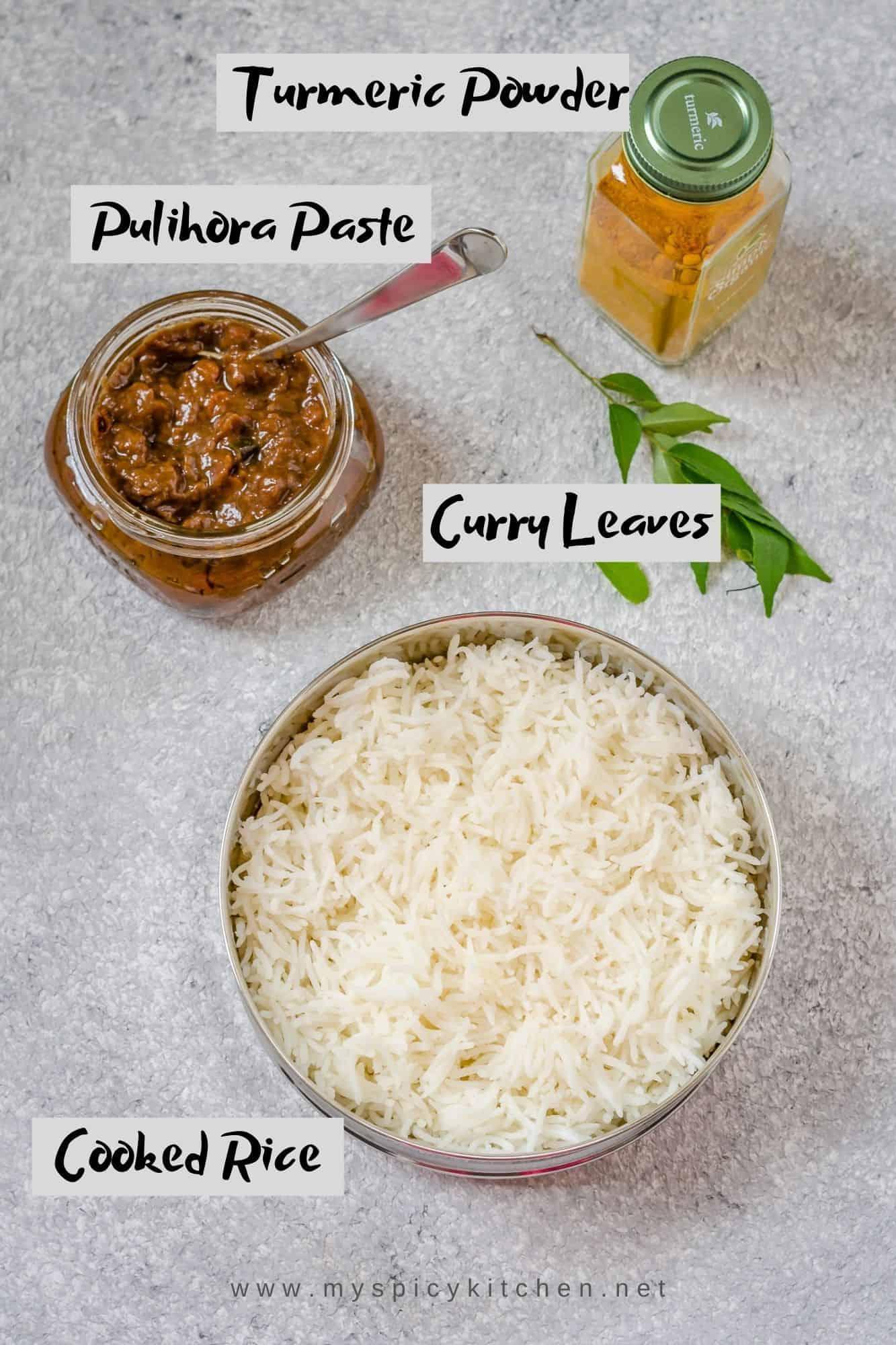Ingredients for tamarind rice - cooked rice, pulihora paste and turmeric powder.