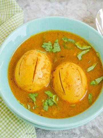 Bowl of guddu pulusu with 2 eggs.